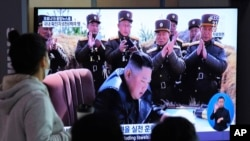 People watches a television screen showing a file image of North Korean leader Kim Jong Un during a news program at the Seoul Railway Station in Seoul, South Korea, Saturday, March 21, 2020. North Korea on Saturday fired two presumed short-range…