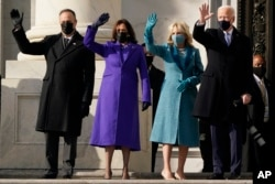 President-elect Joe Biden, his wife Jill Biden and Vice President-elect Kamala Harris and her husband Doug Emhoff arrive at the steps of the U.S. Capitol for the start of the official inauguration ceremonies, in Washington, Wednesday, Jan. 20, 2021