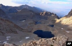 This undated photo provided by the Inyo County Sheriff's Department shows 6th lake below Mount Williamson where authorities say the skeletal remains of a person were discovered on Oct. 7, 2019 beneath the state's second-highest peak.