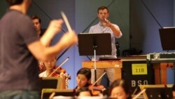 Miles Salerni plays the triangle during a rehearsal of Wagner's 'Seigfried's Rhine Journey' with the Tanglewood Music Center Orchestra.
