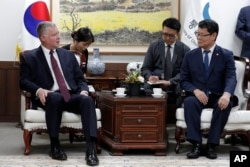 South Korean Unification Minister Kim Yeon Chul, right, and U.S. Special Representative for North Korea Stephen Biegun, left, talk during their meeting at a government complex in downtown Seoul, South Korea, Aug. 21, 2019.
