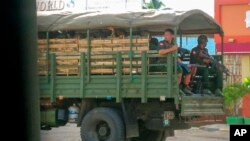 FILE - Military troops and police go on patrol at Kayah state, eastern Myanmar, May 23, 2021.