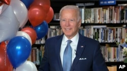 In this image from video, Democratic presidential candidate Joe Biden smiles after the roll call vote during the second night of the Democratic National Convention, Aug. 18, 2020.