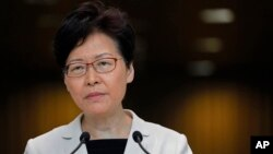 Hong Kong Chief Executive Carrie Lam Listens to reporters' questions during a press conference in Hong Kong Tuesday, Aug. 27, 2019.