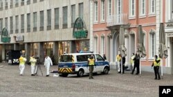 Police officers are pictured at the scene of an incident in the city of Trier, Germany, Dec 1, 2020.