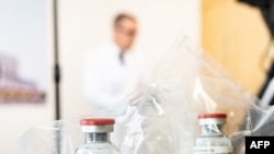 FILE - Vials of the drug remdesivir are seen at a hospital in Germany, April 8, 2020.