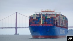FILE - In this May 14, 2019, photo, a Cosco Shipping container ship passes the Golden Gate Bridge in San Francisco bound for the Port of Oakland.