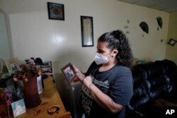 FILE - Roxanne Schaefer is pictured in her apartment in West Warwick, R.I., July 27, 2021. Schaefer, months behind on rent, was bracing for the end of a federal residential eviction moratorium at midnight Saturday.