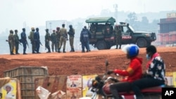 FILE - Security forces gather on election day in Kampala, Uganda, Jan. 14, 2021. Authorities in Uganda recently suspended 54 aid groups, but those groups say they are being targeted for political reasons.