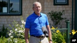 Former President George W. Bush speaks after having lunch with Sen. Susan Collins, R-Maine, Friday, Aug. 21, 2020, in Kennebunkport, Maine. Bush on Friday backed Collins in his first public endorsement of the 2020 election cycle. (AP Photo/Mary…