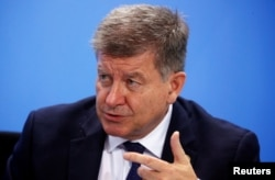 International Labor Organization Director-General Guy Ryder attends a news conference after a meeting at the Chancellery in Berlin, Oct. 1, 2019.