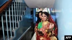 Transgender woman Tista Das, 38, arrives for her wedding to a transgender man Dipan Chakravarthy, 40, in Kolkata, India, Aug. 5, 2019.