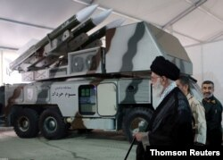 """Iran's Supreme Leader Ayatollah Ali Khamenei is seen near a """"3 Khordad"""" system which is said to had been used to shoot down a U.S. military drone."""