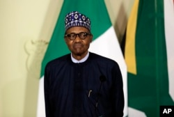 FILE - Nigerian President Muhammadu Buhari attends a press briefing after meeting with South African President Cyril Ramaphosa in Pretoria, South Africa, Oct. 3, 2019.