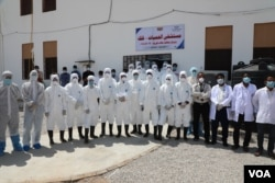 Health workers are seen in Hadramout province, where Yemen recorded its first COVID-19 case last month, on May 1, 2020. (Courtesy of Hadramout's health department)