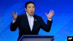 Democratic presidential candidate entrepreneur Andrew Yang speaks during a Democratic presidential primary debate, Friday, Feb. 7, 2020, hosted by ABC News, Apple News, and WMUR-TV at Saint Anselm College in Manchester, N.H.