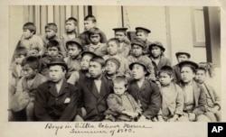 FILE - This photo made available by the Presbyterian Historical Society, Philadelphia, shows students at a Presbyterian boarding school in Sitka, Alaska, in the summer of 1883.