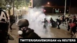 Protesters confront with the police near an Immigration and Customs Enforcement centre in Portland, Oregon, Aug. 20, 2020, in this still image from a video obtained from social media.