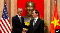 Barack Obama et Tran Dai Quang au palais présidentiel à Hanoi, Vietnam, le 23 mai 2016.(AP Photo/Carolyn Kaster)