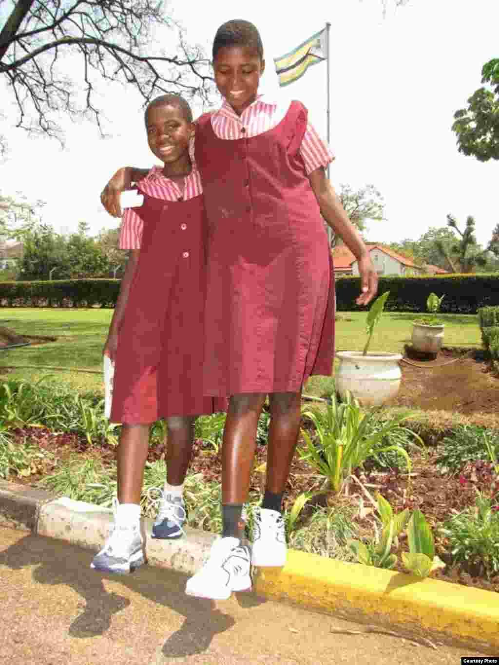 Girls at a Zimbabwean school wearing new shoes shipped from USA. (Photo: Noah Manyika)