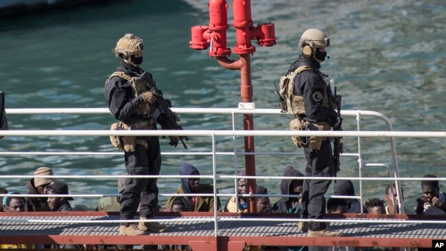 Armed forces stand on board the Turkish oil tanker El Hiblu 1, which was hijacked by migrants, in Valletta, Malta, March 28, 2019. A Maltese special operations team boarded the tanker Thursday and took control of it before escorting it to a Maltese port.