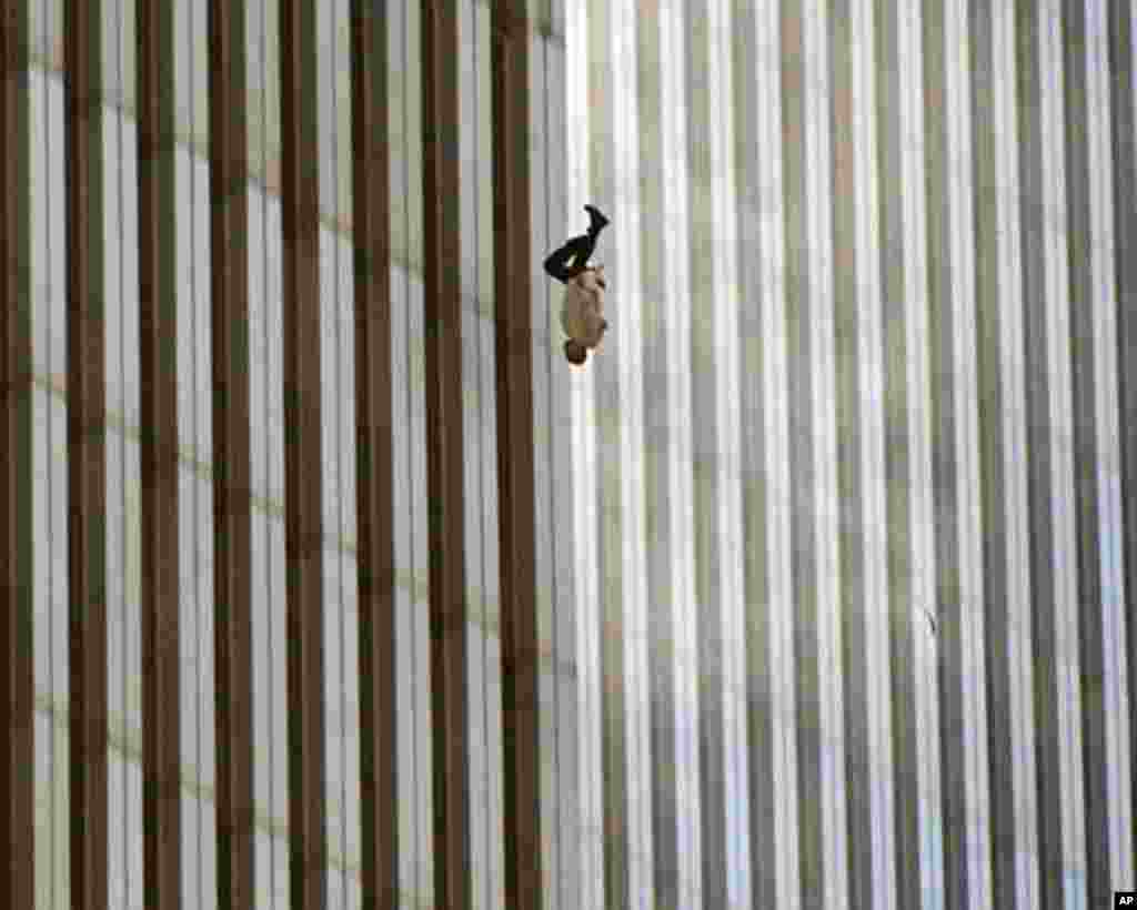 A person falls from the north tower of New York's World Trade Center Tuesday Sept. 11, 2001after terrorists crashed two hijacked airliners into the World Trade Center and brought down the twin 110-story towers. (AP Photo/Richard Drew)