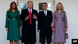 From left, first lady Melania Trump, President Donald Trump, Czech Prime Minister Andrej Babis and his wife, Monika Babisova, pose outside the Oval Office of the White House, in Washington, March 7, 2019.