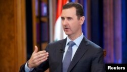 Syria's President Bashar al-Assad speaks during an interview in Damascus, Sept. 19, 2013.