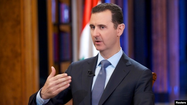 Syria's President Bashar al-Assad speaks during an interview with Fox News channel in Damascus, Sept. 19, 2013.