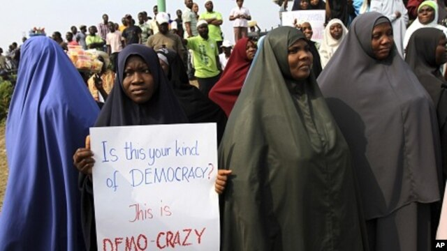 Muslim women attend a rally at Gani Fawehinmi freedom square on the fifth day of a protest against a fuel subsidies removal, in Lagos January 13, 2012.