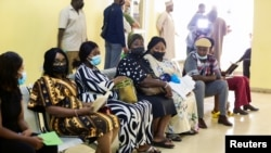 FILE - People wait after receiving the AstraZeneca's COVID-19 vaccine at the National Hospital in Abuja, Nigeria, March 31, 2021.