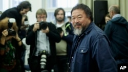 Chinese artist Ai Weiwei arrives for a news conference about his Einstein Professorship at the University Of Arts (UDK) in Berlin, Oct. 26, 2015.