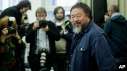 FILE - Chinese artist and dissident Ai Weiwei arrives for a news conference in Berlin, Oct. 26, 2015.