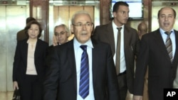 Leader of the opposition of the Syrian National Council, Burhan Ghalioun, center, and other members leave a meeting with Egyptian Foreign Minister Mohamed Kamel Amr in Cairo, Egypt, April 23, 2012.