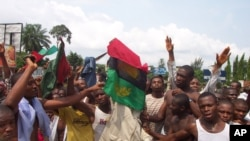 ** FILE ** Supporters of the Movement for the Actualization of the Sovereign State of Biafra, MASSOB, protest in the streets of Aba, eastern Nigeria, Dec. 5 2005. MASSOB has struck chords among many Igbo.