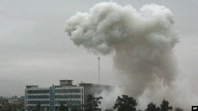 Dust and smoke rise after an explosion in Kandahar, Afghanistan, Feb 12, 2011