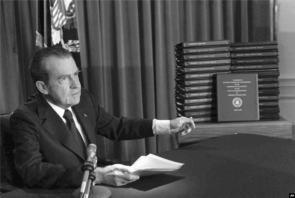 President Richard M. Nixon is shown pointing to the transcripts of the White House tapes in this April 29, 1974, file photo, after he announced during a nationally-televised speech that he would turn over the transcripts to House impeachment investigators