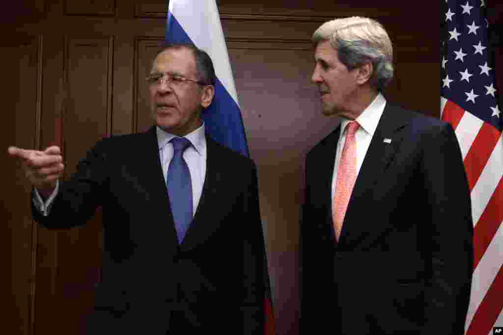 Russian Foreign Minister Sergei Lavrov gestures while standing with U.S. Secretary of State John Kerry in Berlin, Germany, Feb. 26, 2013.