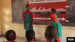 Schoolgirls practice how to protect themselves from assault at one of the classes Ujamaa Pamodzi Africa offers in Malawi