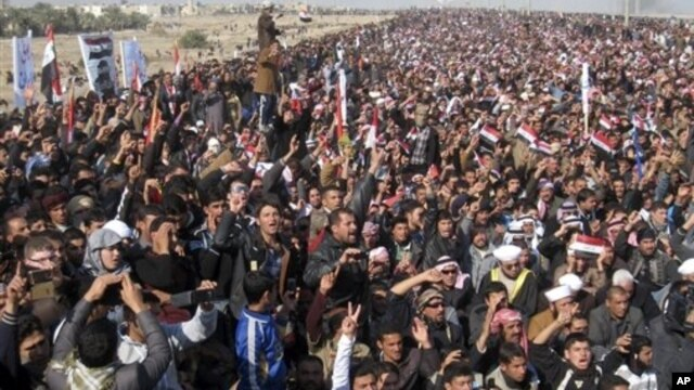Protesters chant slogans against Iraq's Shiite-led government during a demonstration in Fallujah, Jan. 4, 2013.