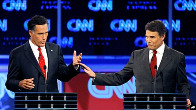 Republican presidential candidates former Massachusetts Gov. Mitt Romney, left, and Texas Gov. Rick Perry gesture during a Republican debate Monday, Sept. 12, 2011, in Tampa, Fla.