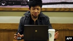A man uses his computer in a coffee shop in Shanghai, (File photo).