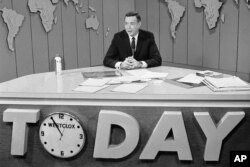FILE - Hugh Downs hosts the Today show on NBC, March 10, 1966.