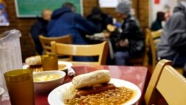 A lunch meal is served in a New York City soup kitchen (file photo).