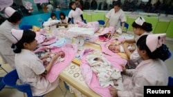 Infants undergo a daily medical examination at a maternal and child health care hospital in Taiyuan. Experts say China's new two-child policy could spur economy because more child-related service will be needed.