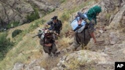 FILE - Rebels of the Kurdistan Workers Party (PKK) are seen in Turkey near the border with Iraq, May 2013.