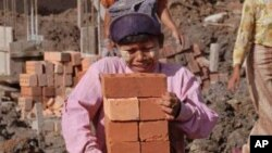 Burmese girls haul bricks at construction site in Rangoon Thursday, July 11, 1996. With child labor laws being non existant, many children are used to work on building sites and road crews. (AP Photo/Richard Vogel)