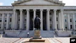 FILE - A statue of former Treasury Secretary Albert Gallatin stands outside the Treasury Building in Washington.
