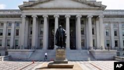 FILE - A statue of former Treasury Secretary Albert Gallatin stands outside the Treasury Building in Washington.