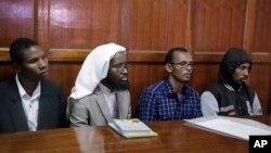 Para terdakwa dari kiri ke kanan: Rashid Charles Mberesero, Sahal Diriye Hussein, Hassan Aden Hassan dan Mohammed Abdi Abikar, mendengarkan putusan di pengadilan di Nairobi, Kenya, 19 Juni 2019.
